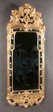 Georgian style gold leaf mirror with pierced and arch shell pediment and with leaf and floral design at the top and the base, 62