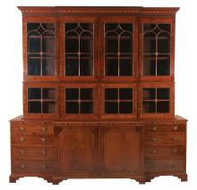 Fine Sheraton mahogany breakfront bookcase, crown moulding has blind fret carving and satinwood inlay, top has arched mullion glass doors, base is fitted with pull out slides, center section has double panel doors, each end has four graduated drawers on bracket feet, c.1790-1800, 98