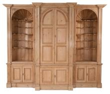 Exceptional pine breakfront bookcase with open concave end section, arch panel doors in the center and panelled doors in the base, 110