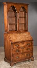 Queen Anne style walnut bureau bookcase with arched glass panel doors, cross banded fall front, good fitted interior and bracket feet, c.1890, 34