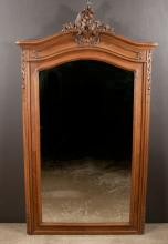 Louis XV walnut bevelled edge mirror with scroll and floral carved pediment and scroll carving on each side, 65