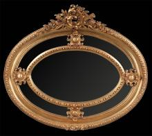 Oval Louis XV design gold gilt mirror with pierced leaf and scroll carved pediment and floral carving at the base, 42