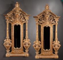 Pair of moulded Louis XIV design gold gilt mirrors with arched and scroll pediment with mask design, fluted columns on the side and urn with dragon handles at the base, 52.5