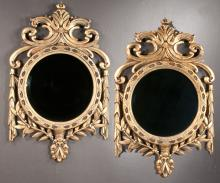 Pair of English circular bevelled mirrors in carved and gilt frames with swag decoration , 30