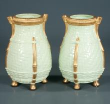 Pair of Grownfield porcelain footed vases with a basket weave design and gold highlights, 7.5