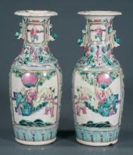 Pair of Chinese porcelain vases with panel scenic, figural and floral decoration with foo lion handles, c.1880, 10