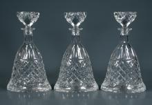 Set of three cut crystal wine decanters with diamond cut design and cut stoppers, 12
