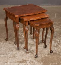 Nest of three Queen Anne style walnut tables with serpentine shaped tops on cabriole legs with shell carved knees and pad feet, 19