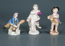 Meissen porcelain figure of a young boy holding a basket of flowers, 5