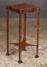 Chippendale style mahogany kettle stand with serpentine shaped top, cluster column legs, candle slide and Marlborough feet, 13