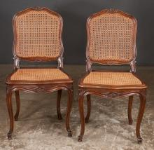 Set of six Country French walnut dining chairs with floral carved back rails with cane panel backs and seats on cabriole legs with scroll carved feet, c.1900, 20