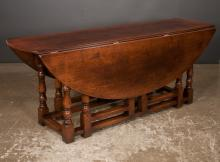 English oak gate leg table with oval shape drop leaves on turned legs with stretchers, 68