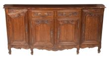 Country French oak buffet with parquetry inlaid top, arched and carved panel doors on the ends, two drawers above two carved doors in the center, c.1900, 89