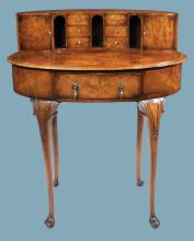 Oval Queen Anne walnut Carlton house desk, top cabinet fitted with two cupboard doors and six drawers on cabriole legs with pad feet, c.1890, 33