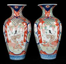 Pair of Imari porcelain vases with cobalt blue, green and bittersweet figural and scenic decorations, 18