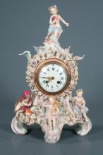 German porcelain mantle clock with floral design and decorated with figures representing the four seasons with enamel dial, 11