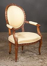Louis XV style walnut fauteuil with floral carved back, carved arms and cabriole legs, c.1900, 25