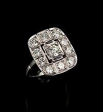 Antique diamond ring with 11 round cut diamonds, approx. 3.00 cts., and two French cut sapphires, c.1920's.