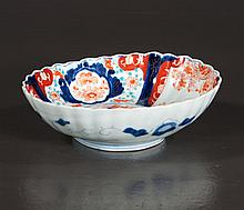 Oval Imari bowl with cobalt blue, green and bittersweet, urn and floral decoration, c.1860, 8.5