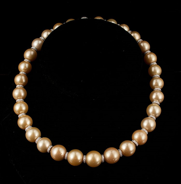 Golden South Sea peal necklace with pearls ranging from 16.0 to 13.00 mm with an 18 kt. white gold clasp with roundels having 478 round brilliant cut diamonds, approx. 6.00 cts.