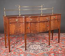 Sheraton style serpentine front mahogany sideboard with satinwood quarter fan and bell flower inlay and on square tapered legs, by Baker Furniture Co., 72