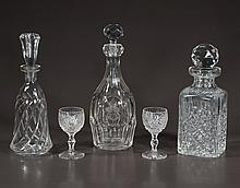 Group of three cut crystal decanters and a group of 11 assorted cut crystal sherry glasses, 14 pieces