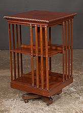 Sheraton style mahogany revolving bookstand with gadroon carved top, 21