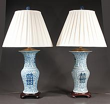 Pair of blue and white Chinese porcelain vases, adapted as lamps with pleated shades, 33