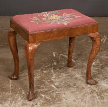 Queen Anne mahogany foot stool on cabriole legs with slipper feet and having floral needlepoint cushion, c.1900, 22