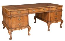 Queen Anne style walnut partners desk with inset leather top, drawers on one side and cupboards on the opposite side, on short cabriole legs with pad feet, c.1900, 72