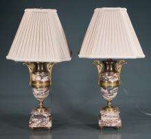 Pair of bronze mounted French marble urns with pierced handles on bronze feet, adapted as lamps with pleated shades, 23