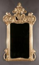 19th century gold gilt Venetian mirror with arched pediment decorated with leaves and clusters of grapes, 51