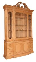Pine breakfront bookcase with dentil work crown moulding, broken arch pediment, top has glass panel doors, base has drawers on each end and double doors in the center, 66