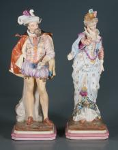 Pair of porcelain figures of a gentleman and lady in royal costumes, 20