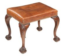 Chippendale style stool on cabriole legs with shell carved knees and ball and claw feet, c.1890, covered in brown leather with nail head trim, 20