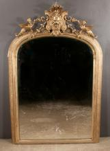 Gold gilt Venetian dome top mirror with shield shaped pediment with lion mask, clusters of grapes on each sides and winged sphinx on each side, c.1830, 64