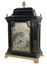 Brass mounted, black lacquered Georgian Irish bracket clock with arched pediment, four acorn shaped finials, silver dial movement with brass mounts, on brass ogee bracket feet, Crosthwaite and Hodges, Dublin, c.1820, 17