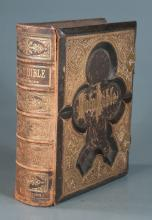Embossed leather bound illustrated Bible with black and white engravings and with brass straps, 13