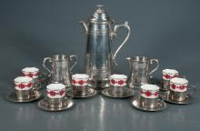 Sheffield pewter coffee pot with dome lid with matching cream and sugar bowl and 8 china cups in pewter holders with underplates, 11 pieces
