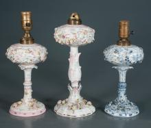 Two blue, yellow and pink porcelain lamps with floral decoration, 13