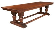 Exceptional walnut dining table with dentil shape apron, base has four turned legs resting on a walnut base with scroll carving on each end of the base, 10' long, 41