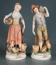 Porcelain figure of a young farm boy carrying a basket of corn on his shoulder and young farm girl carrying a basket of fruit and vegetables, 17