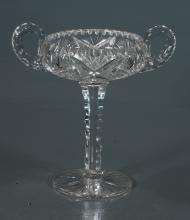 Fancy cut glass compote in the starburst cut design and with double handles, 6