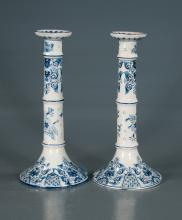 Pair of blue and white Delft candlesticks with floral design, 12