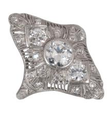 Art Deco platinum filigree diamond ring consisting of one round diamond in the center, weighing 0.70 cts. and also having 20 side old cut diamonds, weighing 0.85 cts
