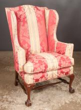 Chippendale style mahogany wing chair with shaped back and on cabriole legs with ball and claw feet and turned stretcher, 33