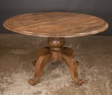 Round oak dining table, base has a turned column and on four cabriole legs with scroll feet, 52