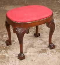 Oval Chippendale style mahogany stool on cabriole legs with acanthus carved knees and ball and claw feet, by Kindel Furn. Co., 21