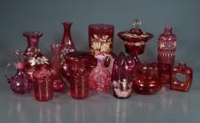 Collection of 17 pieces of cranberry glass vases, tumblers and covered jars