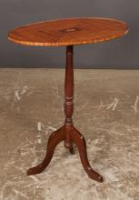 Sheraton style mahogany tripod candlestand with oval top having satinwood medallion inlay, turned column and cabriole legs, 24.5